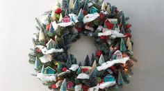 Create a charming scene with tiny cardboard houses and bottlebrush trees -- they're a cinch to spruce up for the season.