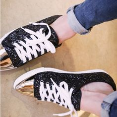 Make a fun, sparkly statement in these sequined sneakers. With their low cut construction, these sneakers are perfect for jeans and shorts. The metallic glossy toe caps give them a modern touch while the sequined uppers are all glitz and glam.  - Low cut sneakers - Lace up front - Pointed toe with metallic toe caps - Sequined uppers - Rubber soles - Colors: Black, Silver