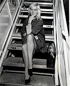 Actress May Britt boarding airplane in New York - Stock Photo