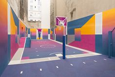 sandwiched between a pair of apartment buildings in paris is the pigalle basketball court – where air balls and alley-oops meet artistic intervention.