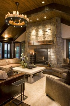 LOVE THE FIREPLACE. OH, AND THE CHANDELIER. gorgeous.