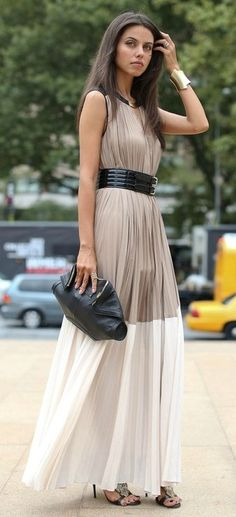 neutral color block (cream and beige) maxi dress with thick black belt, clutch, cuff bracelet, necklace, and heels