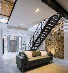 The existing steel beams and wooden floor structure of the upper level were retained. Photo 5 of 14 in A 19th-Century Dutch Workshop Is Now a Stunning, Spacious Loft. Browse inspirational photos of modern living rooms.