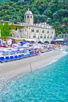 San Fruttuoso, Italy - This picturesque cove on the ferry route from Genoa to Portofino is home to an ancient Benedictine monastery and the underwater Christ of the Abyss statue