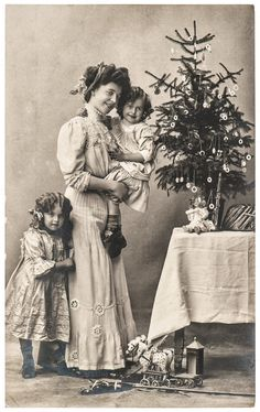 Picture of happy mother and children with christmas tree and antique toys. vintage sepia picture with original film grain and blur stock photo, images and stock photography. Vintage Christmas Photos, Vintage Children Photos, Retro Christmas, Christmas Pictures, Vintage Pictures, Christmas Applique, Old Time Christmas, Christmas Past, Victorian Christmas