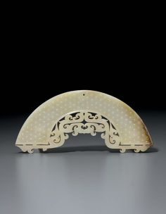 A very rare white jade arc-shaped pendant, huang, China, Late Eastern Zhou dynasty, 5th-4th century BC 1