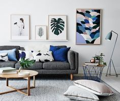 Textured grey carpet, charcoal couch and blue accents