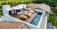 The rooftop terrace features a contemporary outdoor living space, dining room an. The rooftop terr Rooftop Terrace Design, Rooftop Patio, Terrace Floor, Terrace Ideas, Terrace Garden, Moderne Pools, Small Pools, Swimming Pool Designs, Pool Houses
