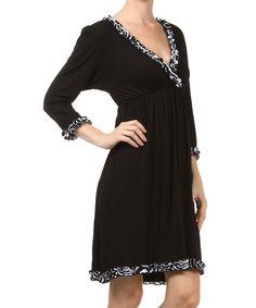 This Black & White Zebra Ruffle Surplice Dress - Women by L & B is perfect! #zulilyfinds