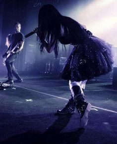 Awesome amy lee style ~ this lady got me into girlie skirts with biker boots! Rock princess