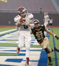 ART TREVINO/Contributor --  Colton Payne hauls in a Tiger touchdown pass from quarterback Dalton Schroller to put Floresville up 7-0 in the first half of its game with Edison last Thursday night.