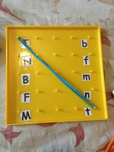 Great for Kindergarten Abc center: matching uppercase and lower case letters. Could use for Math too! Kids always loved the geoboards with different colored elastics Abc Centers, Kindergarten Centers, Preschool Literacy, Preschool Letters, Learning Letters, Kindergarten Reading, Kindergarten Classroom, Literacy Activities, Toddler Activities