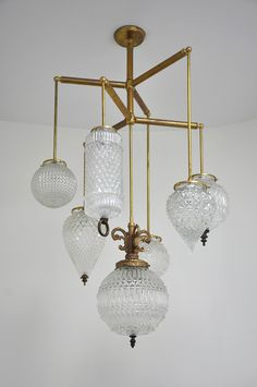 Michelle James lighting combines meticulously selected and assembled vintage parts to create sculptural fixtures imbued with an old world elegance. Custom Lighting, Home Lighting, Modern Lighting, Lighting Design, Nate Berkus, Brass Chandelier, Chandelier Lighting, Vintage Chandelier, Arquitetura