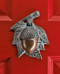 """Acorn Doorknocker:  Who's that tap-tap-tapping at your door? This acorn knocker cheerily announces visitors, while adding a woodland touch to your entry. Solid brass with verdigris finish; 6"""" high x 4"""" wide."""