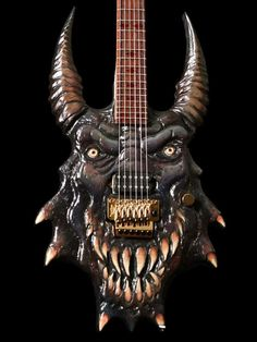 it Looks Like Godzilla with Devil Horns But It is Still a really cool GUITAR!!