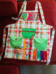 An activity or fidget apron for my lovely friend who doesn't have much vision and she does have dementia but she's a lovely lady.