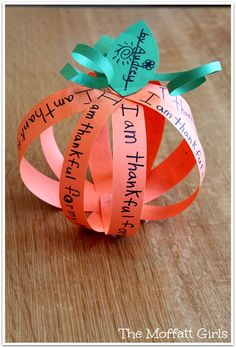 Have students write what they are thankful for on strips of orange paper and then use a fastener to turn them into a pumpkin!  Such an easy Thanksgiving Day craft!