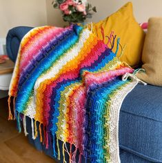 Rainbows are a huge trend right now, and the radiant Rainbow Splash Blanket by HanJan Crochet is our favorite use of these happy colors so far! 🌈 Baby Afghan Crochet, Afghan Crochet Patterns, Crochet Blankets, Crochet Shirt, Baby Patterns, Poncho Patterns, Crochet Vests, Crochet Edgings, Crochet Dishcloths