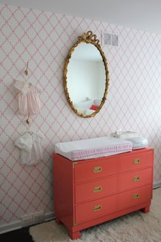 Custom Antique Campaign Dresser - love the vintage dresser and mirror paired with the modern accent wall! #vintage #nursery