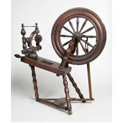 Wooden spinning wheel, Scottish, early century -- from the St Kilda collection in the Glasgow Museum - Scotland.