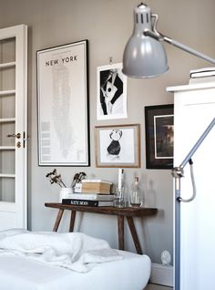 Guide to Manhattan print and rustic bench in the lovely Swedish home of Anna Kvarnström