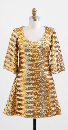 vintage 1960s uber mod gold sequin mini dress | Mad Men fashion | http://www.rococovintage.com