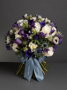 Evening Frost Bouquet - This gorgeous bouquet is made up of white roses, white, purple and blue anemones with purple clematis. From £60, wildatheart.com