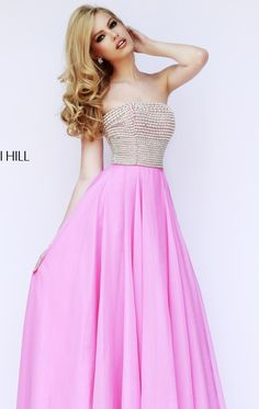 Look dainty and sophisticated in Sherri Hill 8551. This charming evening gown features a strapless neckline. This dress is covered with sparkling beading designed to flatter your charm. Figure defining waist lets the flowing skirt fall naturally to the floor in a sleek cascade of graceful fabric.