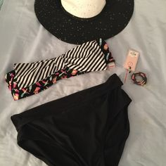 Juicy Couture Adorable Bikini Top XL, Bottoms 16 Juicy Couture Adorable Bikini Top. Size XL. Black with Popsicles on it and a black and white striped bow on the front. Removable straps. NWT Bottoms are a size 16. Not JC but will include. Juicy Couture Swim Bikinis