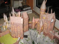 Holy cow, this guy made a paper model version of Hogwarts, including Hogsmead & Hagrid's Hut!! Even a Quidditch field!! @shel bell