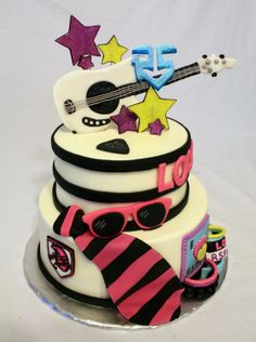 An R5 themed cake with hand made fondant accents.