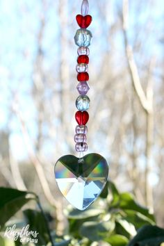 A Heart prism pony bead suncatcher is an easy fine motor craft for kids and adults. They cast beautiful rainbows all around the room when placed in sunlit windows. An easy DIY gift idea for Valentine's day or Mother's Day that kids can make! Diy Locker, Diy Wood Wall, Heart Crafts, Hanging Hearts, Swarovski Crystal Beads, Valentine Day Crafts, Valentine Party, Kids Valentines, Valentine Ideas