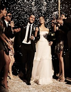 I have yet to attend a wedding with confetti. I just love this shoot... and confetti.