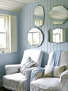 great slipcovered chairs, and mirrors