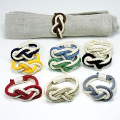 Nautical knotted cotton napkin rings are both practical and romantic. Sold as a package of four of the same color. The figure 8 knot is used in boating as a stopper knot. It is also used to represent
