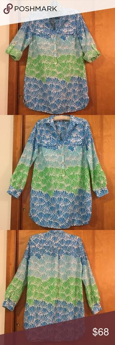 Lilly Pulitzer dress / tunic size S Lilly Pulitzer tunic / dress can be worn with sleeves rolled or wear them long. Breast pocket on either side. Front gold logo button closure and button closure at sleeve ends. Wear as a dress or tunic.abstract she'll print in shades of green and blue. Underarm to underarm 19 inches. Shoulder to bottom of garment 31 3/4 inches. Made from 100% cotton Lilly Pulitzer Dresses