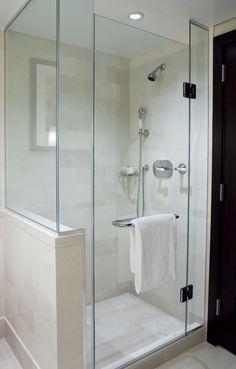 Frameless shower without soffit or return wall, in similar configuration as our space.