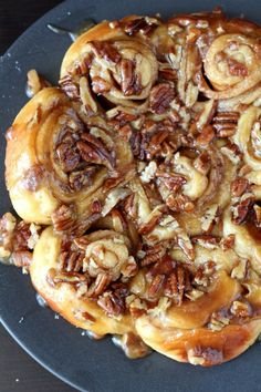 Soft cinnamon rolls covered in a sweet brown sugar, pecan topping - Thanksgiving bread recipes