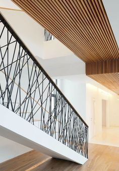 DESIGN DETAIL – Random Railings - This home designed by Monoloko Design, features custom railings on the stairs and the top floor, made from randomly placed steel supports that have been powder coated black. - Luxury Homes Indoor Stair Railing, Interior Stair Railing, Stair Railing Design, Stair Handrail, Staircase Railings, Stair Case Railing Ideas, Staircases, Rustic Staircase, Escalier Design