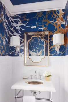 The home's powder room is compact, but Kletzein stuffed it full with a dynamic wall covering, tempered by white, silver, and gold finished—and tall white wainscoting. Blue Powder Rooms, Blue Ceilings, Monochromatic Color Scheme, Metallic Wallpaper, Modern Wallpaper, Real Simple, Home Decor Inspiration, Decor Ideas, Decorating Ideas
