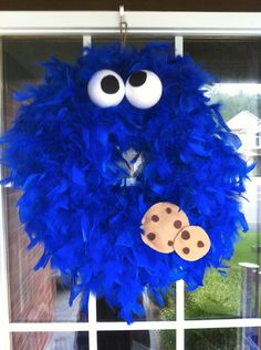 Sesame Street: Cookie Monster Wreath. I'm in LOOOVEE!! Cute for a baby's room or party! Omg