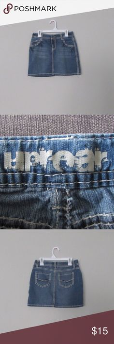 Girls Light Wash Jean Skirt Title: Girls Uprear Jean Skirt  Condition: Pre-owned but in excellent condition  Color: Light Wash  Type: 75% Cotton. 21% Polyester  Size: 12 Girls  Brand: UpRear uprear Bottoms Skirts