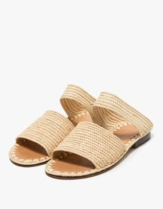 From Carrie Forbes, a minimalist slide in Natural. Featuring a handwoven raffia upper, Italian leather sole, branded insole and a slightly stacked heel.  • Slide in Natural • Handwoven raffia upper • Italian leather sole • Branded insole • Slightly