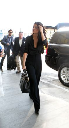 Selena looks professional and sophisticated arriving at LAX. Wonder where she's going...August 18, 2015.