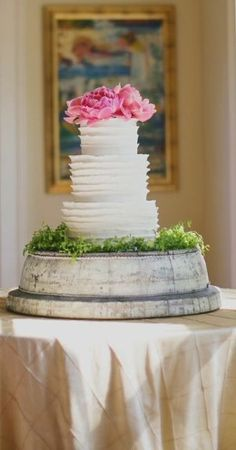 Ruffled wedding cake with peonies on wooden stand #thorne and thistle designs #our labor of love photo