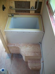 Chest freezer re-purposed as insulated, Japanese-style sit tub and shower pan.