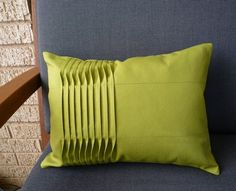 This small pleated pillow cover in a deep autumn olive is one of a kind. Each one I make is a variation of this theme with pleats and stitching