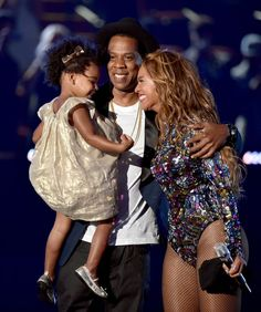 Pin for Later: The Amazing 2014 Award Show Snaps You Probably Forgot About  Jay Z and Beyoncé showed sweet PDA while joined by their daughter, Blue Ivy, on stage at the MTV VMAs.