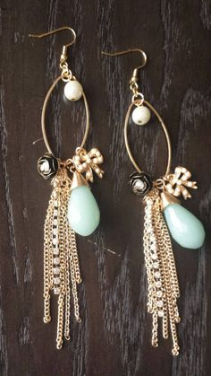 Check out these sassy dangle earrings in my Etsy shop https://www.etsy.com/listing/226231713/gold-dangle-statement-earrings-with