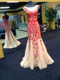 Sherri Hill 2015 Collection Style 11226. An awesome fitted nude and red gown with a flowing tulle bottom.
